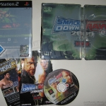 ps2_smackdown_vs_raw_2009_steelbook_content1.jpg